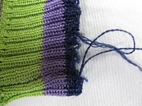 修理 ニットの袖のほつれBefore